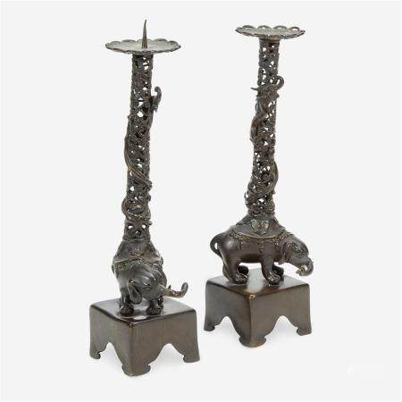 "A pair of Japanese ""Elephant and Dragon"" patinated bronze openwork pricket candlesticks, Edo period, 18th/early 19th Century"