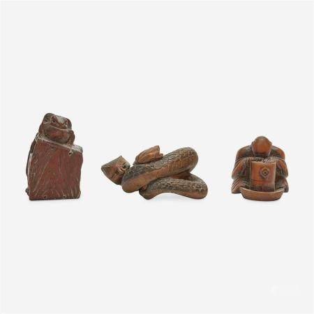 Three Japanese carved wood netsuke: measure and toad, snake and toad, monk and jar,