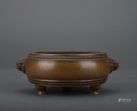 A bronze incense burner