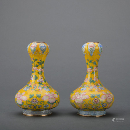 A pair of enamel 'floral' garlic-head vase