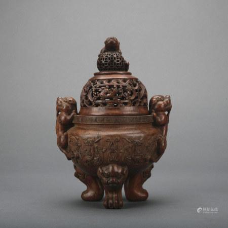 A wood incense burner