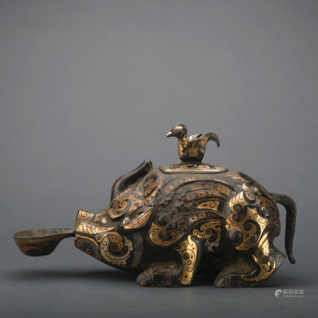 A bronze pig incense burner ware with gold and silver