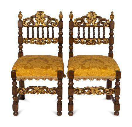 A Pair of Spanish Baroque Style Parcel-Gilt Walnut Slipper Chairs