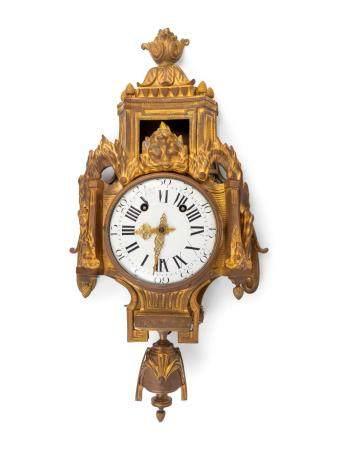 A Louis XVI Style Gilt-Bronze Cartel Clock