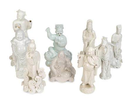 Nine Chinese Blanc de Chine Porcelain Figures of Buddha, Confucius, Sages and Dignitaries