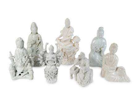 Seven Chinese Blanc de Chine Porcelain Figures of Seated Guanyin and Maidens