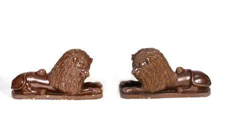 A Set of Four English Brown-Glazed Stoneware Recumbent Lions