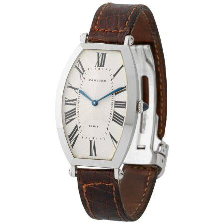 Cartier. Very Rare Tonneau-Shape Wristwatch in Platinum, Reference 2435, With Silver Guillochè