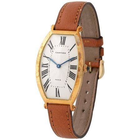 Cartier. Very Rare Tonneau-Shape Wristwatch in Yellow Gold, Reference 2435, With Silver Guilloc