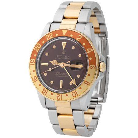 Rolex. Very Rare and Attractive GMT Master Automatic Wristwatch in Steel and Yellow Gold, Refer
