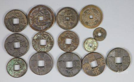 China, a group of 14 bronze coin charms or amulets, Qing dynasty, variously inscribed - two Tai Ping