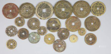 China, a group of 22 bronze or copper coin charms, Qing dynasty, each inscribed 'Zheng De Tong bao',