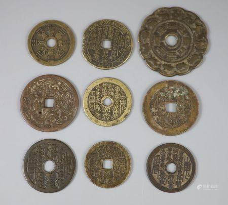 China, 9 bronze charms or amulets, Qing dynasty, seven obv. magical spell characters, rev. Eight