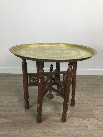 AN INDIAN BRASS TABLE ON FOLDING STAND