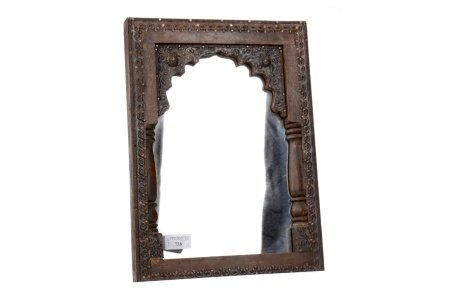 A MOORISH CARVED WOOD FRAMED MIRROR AND A PLATED FLORAL PLAQUE