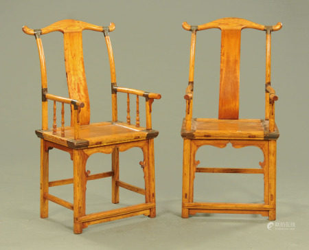 A pair of Chinese elm armchairs. Width across arms 54 cm, height to top of back 116 cm.