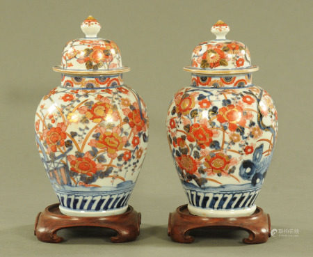 A pair of 19th century Imari porcelain lidded vases,