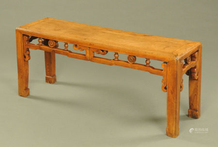A Chinese stained wooden rectangular stool, with half round spindle mouldings to the pierced frieze.