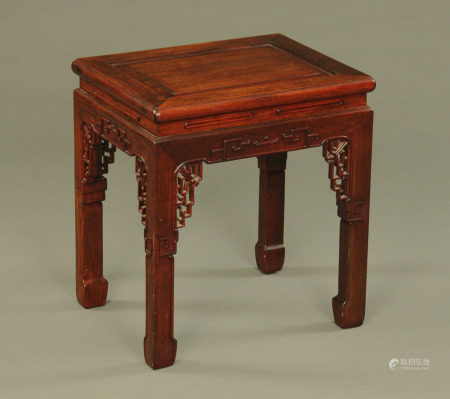 A Chinese hardwood jardiniere stand, rectangular with pierced corner brackets.