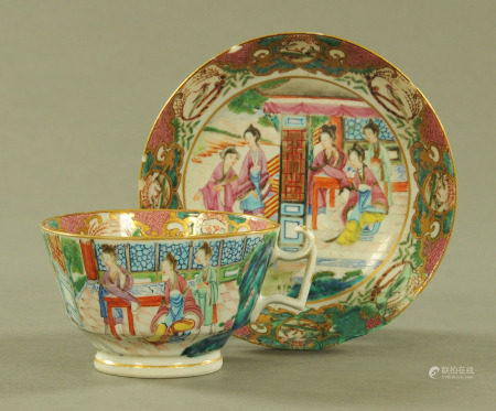 A late 18th/early 19th century Chinese polychrome cup and saucer, saucer diameter 16 cm.