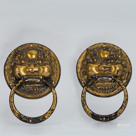 A gilt bronze knocker
