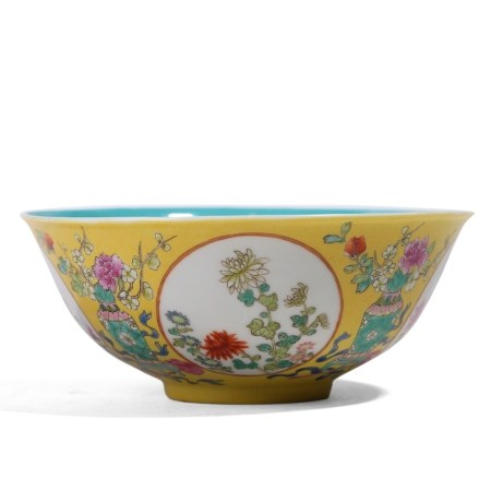 A CHINESE YELLOW-GROUND FAMILLE-ROSE 'FLORAL' BOWL