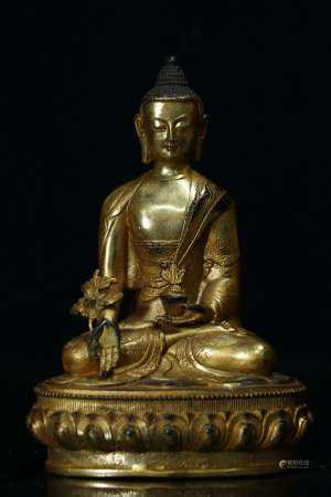 GILT BRONZE CAST SHAKYAMUNI SEATED FIGURE