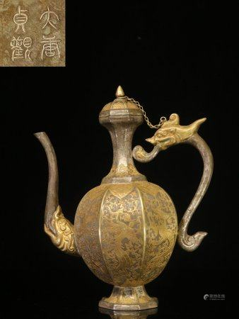 SILVER GILT AND CARVED 'MYTHICAL BEAST' LOBED WINE EWER WITH LID
