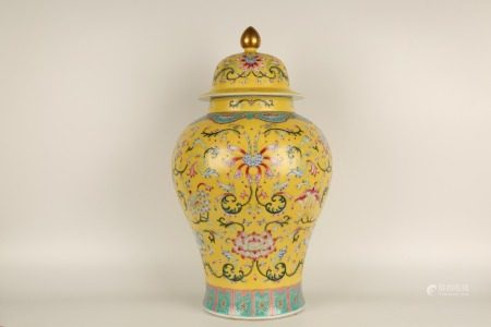 YELLOW GROUND CARVINGS AND FAMILLE ROSE FOLIAGE GENERAL JAR