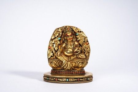 Tibetan Gilt Bronze Figure of Jambhala