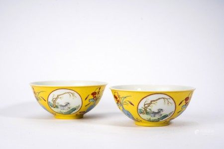 Chinese Pair of Yellow Ground Famille Rose 'Ram' Bowls