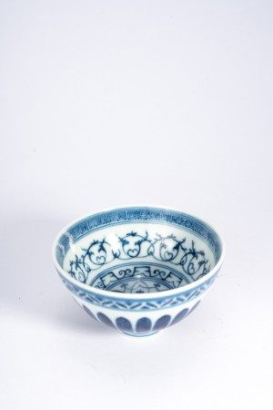 Chinese Blue and White Bowl, stylized floral scrolls painted in interior, the exterior encircled with lotus lappet band, with lacquered stand