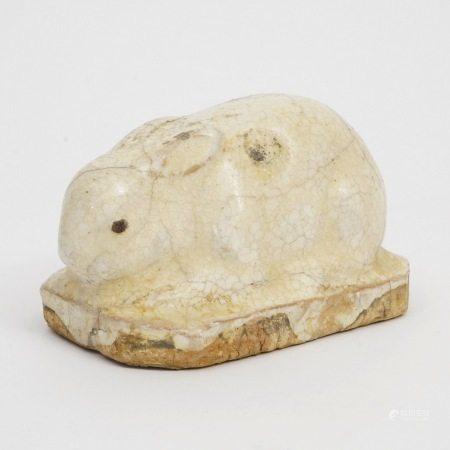 A white-glazed rabbit, Tang Dynasty 唐白釉兔子