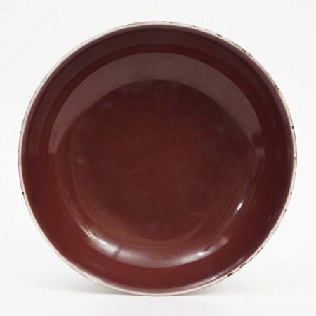A red glaze plate, Qianlong period, Qing Dynasty 清乾隆红釉盘