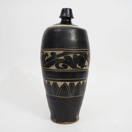 A black glaze carved vase, Song Dynasty 宋代黑釉剔花梅瓶