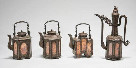 GROUP OF FOUR CHINESE PEWTER COVERED TEAPOTS