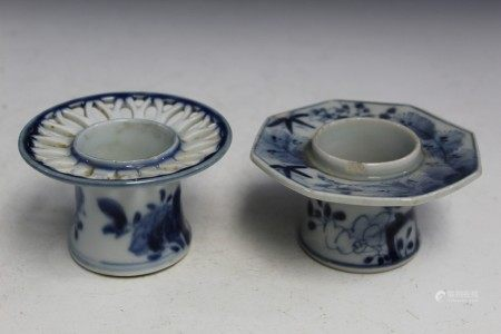 Two Japanese blue and white porcelain candle holders.