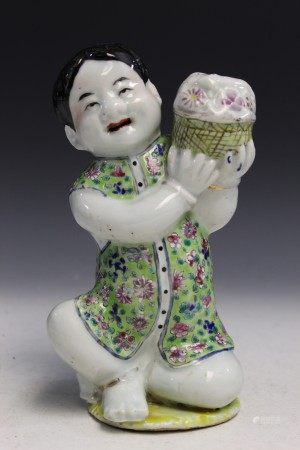 Chinese famille rose porcelain statue of a boy holding