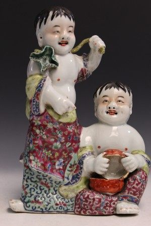 Chinese famille rose porcelain statue of two boys.