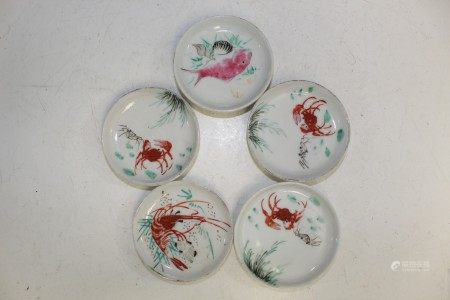 Group of five Chinese porcelain saucers.