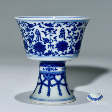 A BLUE AND WHITE 'LOTUS' STEM CUP, QIANLONG MARK