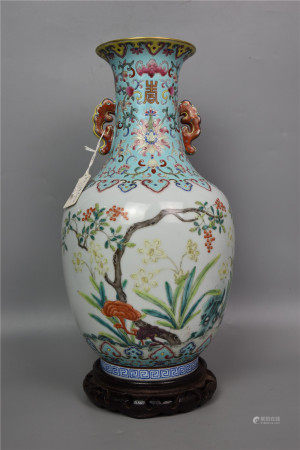 Daoguang of the Qing Dynasty-turquoise green-glazed double-ear famille rose vase with flowers and longevity
