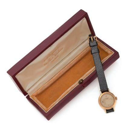 BREGUET REF. B 4726. A 18K gold quartz lady's watch by Breguet. Original manual winding movement damaged joint.