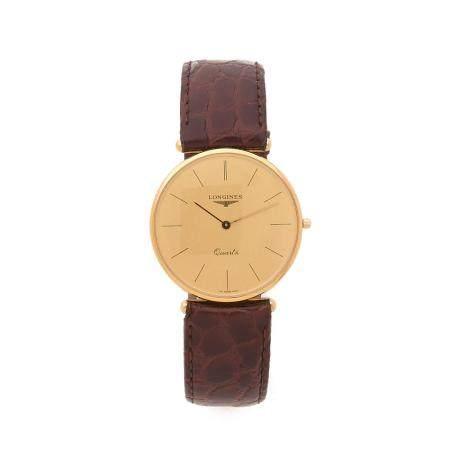 LONGINES A 18K gold quartz wristwatch by Longines.
