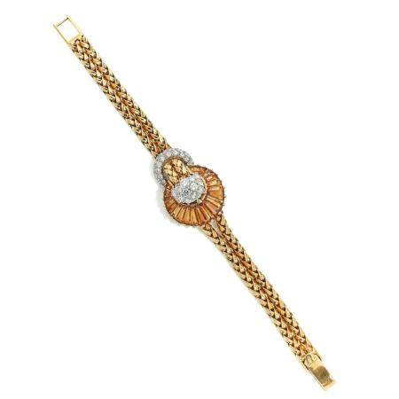 OMEGA DUOPLAN A 18K gold, diamond and citrine manual winding lady's watch by Omega, from the 40's.