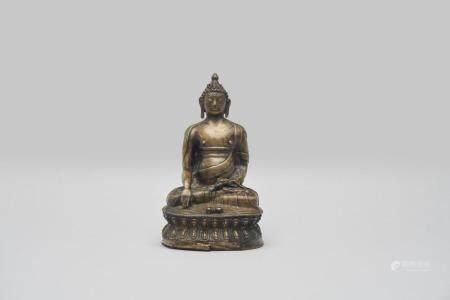 A brass figure of Buddha Vajrasana