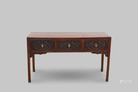 A huanghuali and hongmu three-drawer desk Qing dynasty