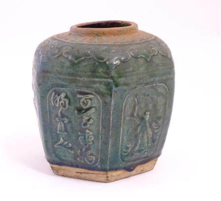 A Chinese hexagonal Shiwan ginger jar / vase with moulded floral, foliate, bird and script detail