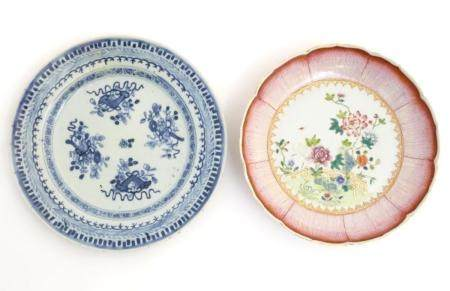 An 18thC Chinese blue and white plate decorated with Daoist emblems, and banded patterned borders.
