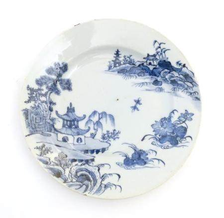 """A Chinese blue and white plate with a landscape scene with pagodas, flowers, etc. Approx. 9"""""""